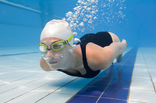 Swimming with contacts can result in eye irritation or infection. For those who do, swim goggles can help protect the eyes from waterborne contaminants.