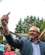 Mayor Henry Braun releases a butterfly into the garden.