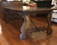 This exceptional 8 ft. gnarled pine table is one of the beautiful furniture pieces available at European Splendor in Louisville, Kentucky.