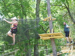 Navigating some of the tree-to-tree elements along the courses at The Adventure Park at Nashville