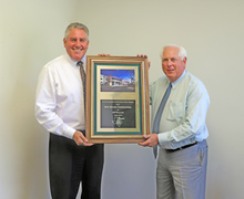 President Ed McGuire (left) and Executive Vice President Larry Knox (right) displaying the 2017 OCA Award