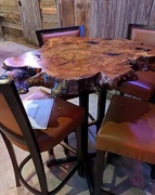 River City Wood Design created a custom-made wooden bar table out of a live edge cut of Walnut Burl for Troll Pub in Louisville, Kentucky.
