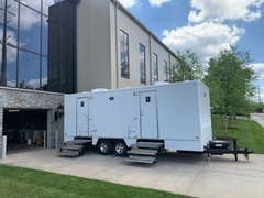 The 24' Urban Restroom Trailer features seven stalls split among men and women, running water sinks, flushable toilets, wood grain floors, and offers unbeatable comfort and class.