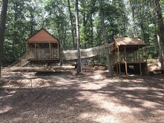 The Adventure Playground includes some unusual features not found at the typical playground. The treehouse on the left is suspended and sways a bit-just enough for fun.