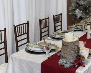 Festive holiday table setting from Special Event Rentals. The best in holiday party planning and rentals.