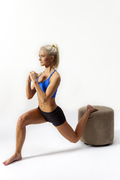Fitness model Krista Klumpp performs a perfect split squat.