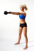 Fitness model Krista Klumpp performs a perfect kettlebell swing.