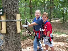 The Adventure Park presents fun challenges for all ages. Here grandmother and grandson climbed together. (Photo by Anthony Wellman)