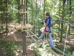"""Crossing one of the """"elements"""" at The Adventure Park at The Discovery Museum. The climbing experience at The Adventure Park at Storrs will be similar. (Photo by Anthony Wellman)"""