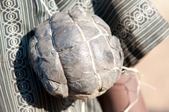 "A child in Zambia shows us his ""soccer ball,"" which is made out of trash bags and twine.<br />"