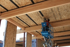 Structural insulated panels (SIPs) help create tight, well-insulated building envelopes.