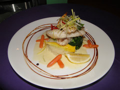 Several Cayman restaurants feature lionfish appetizers and<br />