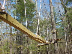 """The Park is more than just zip lines. The fun is in figuring out how to cross each of the many """"elements"""" or challenge bridges at The Adventure Park at Storrs. (photo by Anthony Wellman)"""
