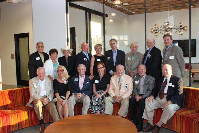 Adcraft Club of Detroit president, Sherrie Weitzman, sitting alongside all current and past Adcraft Hall of Fame inductees.