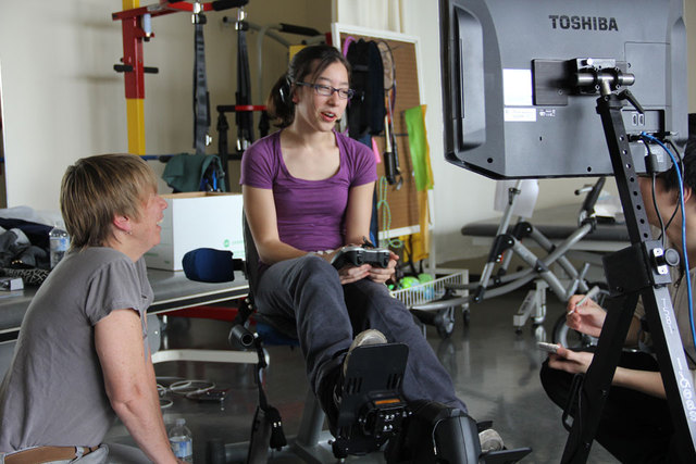 Lara Wong, a client at Holland Bloorview, provides feedback on the Exergame technology to senior scientist Dr. Virginia Wright.<br />
