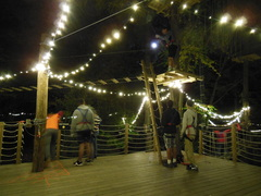 """A starting platform under the new """"twilight lighting"""" during an illuminated night climb at one of the Outdoor Venture Group's Adventure Parks."""