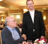 Health Minister, Terry Lake greets Jack Diamond, a tenant at Menno Place