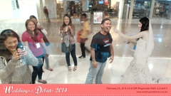 Mall-goers take a bite of the cake from an Augmented Reality bride