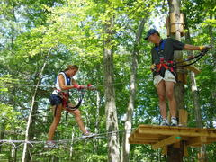 On assignment for a story Sarah Cody, a reporter from Connecticut Fox TV, climbs with Storrs Adventure Park partner Chris Kueffner. (photo by Anthony Wellman)