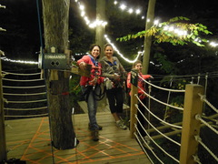 """Night Climbing at The Adventure Park - Strings of LED lights strung in the trees will create a """"perpetual twilight"""" for these climbers for their after-dark treetop thrills. (photo: Anthony Wellman)"""