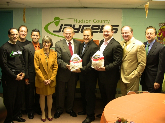 Senator Robert Menendez, ACMG CEOs Thomas Shipley and Andrew Surwilo, Mayor Healy, Housing Authority officials and members of the Jaycees gear up to give out 350 turkeys to local residents