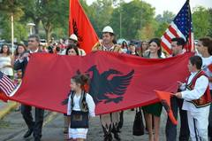 Albanian Ambassador to the U.S., Gilbert Galanxhi and General Consul of NY, Dritan Mishto walk with the flag in the parade at the Festival in Michigan: Sept 2014