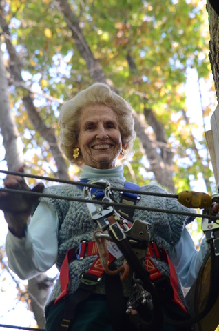 """Wearing a triumphant smile Barbara Stetson looks down from one of the """"aerial trails"""" at The Adventure Park at The Discovery Museum. (Photo: Outdoor Ventures)"""