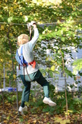 """Barbara Stetson rides the zip line, the final """"element"""" of the aerial trail she climbed at The Adventure Park at The Discovery Museum. (Photo: Outdoor Ventures)"""