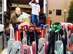 Vacuum Authority owner Russell Gay unloads 25 Oreck vacuum cleaners he donated to Louisville's Family Scholar House this holiday season.