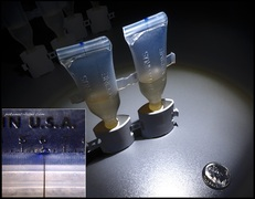 10 micron leak test hole in polymer vials.