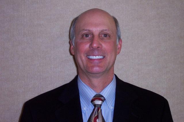 Dr. Eugene Meyerding works with Children's Program to provide affordable dental care to children in his community.
