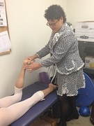 Dr. Stacie Grossfeld examines a ballerina with the Louisville Ballet at Orthopaedic Specialists. Dr. Grossfeld is a sports medicine doctor for the dancers.