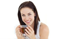 Woman Sipping Quit Tea
