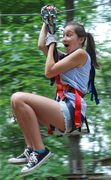 Zip lines are just part of the fun at The Adventure Park at Long Island. Judging from this climber's expression...a LOT of fun! (Photo: Outdoor Ventures)