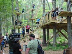 "Theresa Caputo (TV's ""Long Island Medium""--standing on starting platform) has a lot of company in the treetops at The Adventure Park at Long Island. (Photo: Anthony Wellman, Outdoor Ventures)"