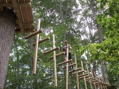 Besides zip lines all climbers navigate different challenge bridges between tree platforms at The Adventure Park. (Photo: Anthony Wellman, Outdoor Ventures)