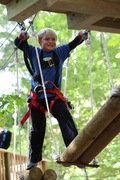 """Smiles in the treetops. The Adventure Park at Frankenmuth offers five different """"aerial trails"""" from beginner through advanced levels. (Photo: Outdoor Ventures)"""