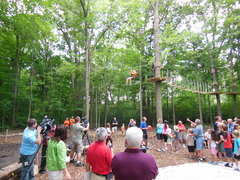 The cameras and crowd, on opening day in 2013 at The Adventure Park at Frankenmuth, observe zip line activity. (Photo: Anthony Wellman, Outdoor Ventures)