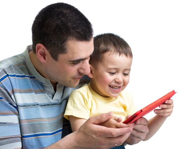 Father and son passing wait time in the waiting room with an Atlas tablet.