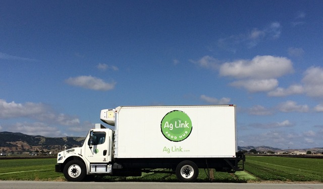 One of Ag Link's new Food Hub trucks picking up fruit and veggies