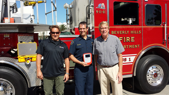 The Beverly Hills Fire Department received a HazSim System through the Corporate Grant Program.  L-R: HazSim CEO, Phil Ambrose, Firefighter, Manny Rosales, E&B Natural Resources Rep, Paul Langland