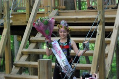 Sabrina Loftus, Lil' Miss Adventure Park 2015, wearing both her tiara and winner's headpiece, on the steps of the starting platform at The Adventure Park at West Bloomfield.