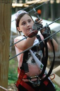 A Lil' Miss Adventure Park contestant pays close attention to her safety clips during her climb at The Adventure Park at West Bloomfield.