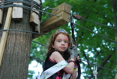 Face painting and a tiara make for an excellent climb at the Lil' Miss Adventure Park pageant on July 1, 2015.