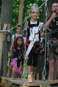 Contestants walk the catwalk as MC Thomas Knuth, right, makes the announcements at the Lil' Miss Adventure Park pageant July 1, 2015.