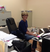 Vacuum Authority Office Manager, Sharon Schnatter, is busy working in her new office space at Vacuum Authority headquarters in Jeffersonville, IN.