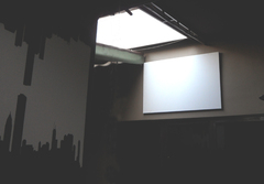 A bit of creativity and this QuietFiber panel, covered in plain white canvas, became a screen for streaming video from inside the club (while clandestinely absorbing sound).