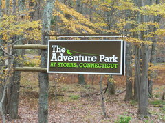 The Adventure Park roadside sign in the autumn foliage  at 2007 Storrs Road in Storrs, CT