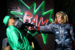 """A super hero battles it out with a villain at """"The Haunted Forest"""" at The Adventure Park at West Bloomfield, MI. (Photo: Outdoor Ventures)"""