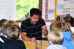 Artist Raul Gonzalez discussing graphic novels with students